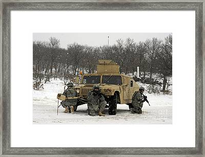 U.s. Soldiers Take Cover Framed Print