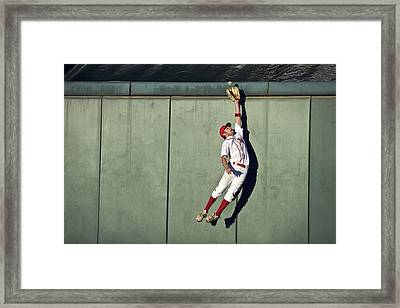Usa, California, San Bernardino, Baseball Player Making Leaping Catch At Wall Framed Print by Donald Miralle
