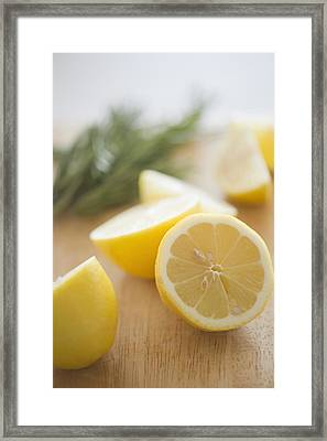 Usa, New Jersey, Jersey City, Lemon On Chopping Board Framed Print by Jamie Grill