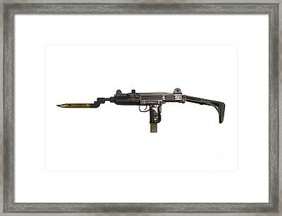 Uzi 9mm Submachine Gun With Attached Framed Print by Andrew Chittock