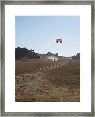 Vehicle Pulling A Couple Doing Tandem Parasailing Framed Print by Ashish Agarwal