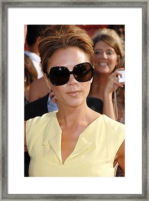 Victoria Beckham At Arrivals Framed Print by Everett