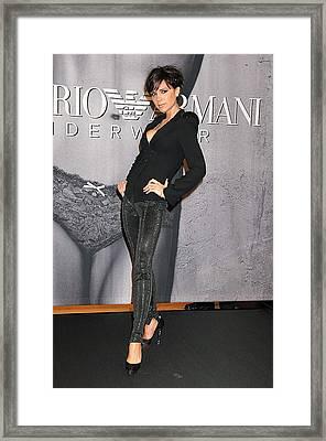 Victoria Beckham Wearing An Emporio Framed Print by Everett