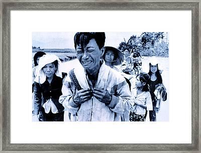 Vietnam War A Head Of Family Weeps Framed Print by Everett