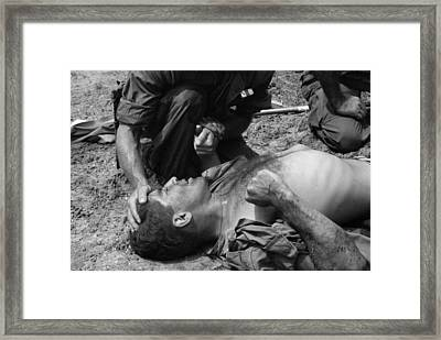Vietnam War. Us Marine Wounded Framed Print by Everett