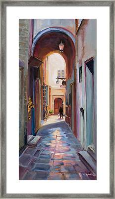View Down A Street In Cortona Framed Print by Jane Woodward