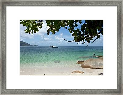 View From A Beach Of A Speedboat In The Sea Framed Print by Caspar Benson