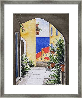 View From The Arch Framed Print by Regina Ammerman