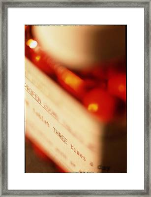 View Of A Bottle Of Ibuprofen Pills Framed Print by Jeremy Walker