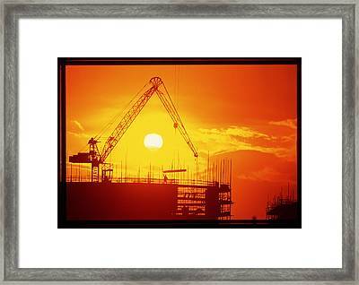 View Of A Construction Site At Sunset Framed Print by Jeremy Walker