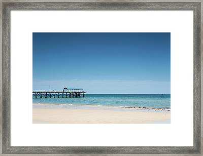 View Of A Pier From A Sandy Beach Framed Print by Caspar Benson