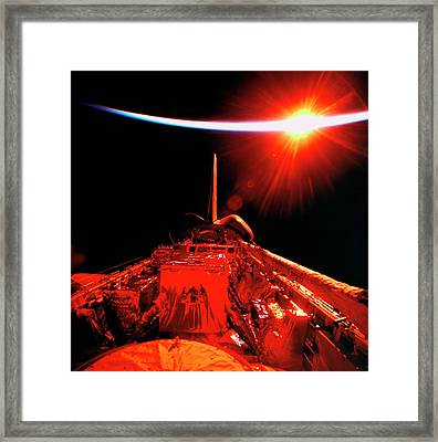 View Of An Eclipse From Space Framed Print by Stockbyte