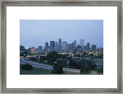 View Of The Denver Skyline At Twilight Framed Print by Richard Nowitz