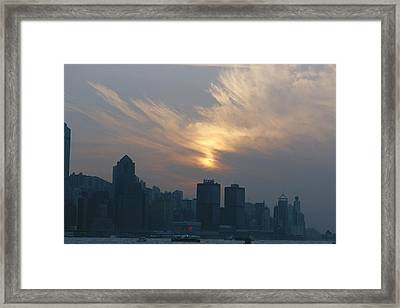 View Of The Hong Kong Skyline At Sunset Framed Print by Raul Touzon