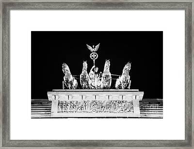 viktoria with quadriga on top of the Brandenburg gate at night Berlin Germany Framed Print by Joe Fox