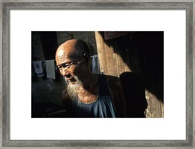 Village Elder At Doorway, Yangdi Framed Print by Raymond Gehman
