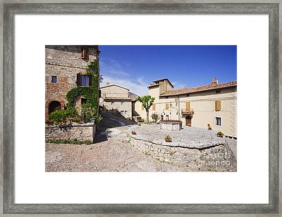 Village Square And Well At Rocca Dorcia Framed Print by Jeremy Woodhouse