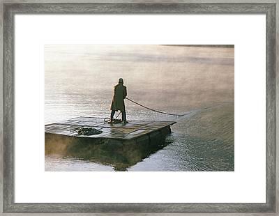 Villager On Raft Crosses Lake Phewa Tal Framed Print by Gordon Wiltsie