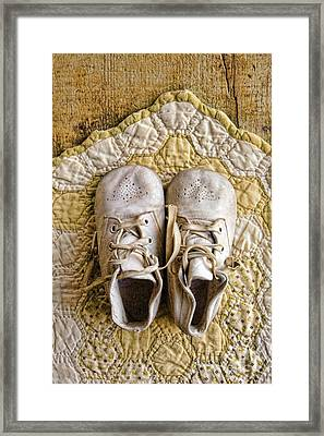 Vintage Baby Shoes On Yellow Quilt Framed Print by Jill Battaglia