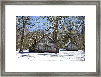 Vintage Buildings In The Winter Snow Framed Print by Susan Leggett