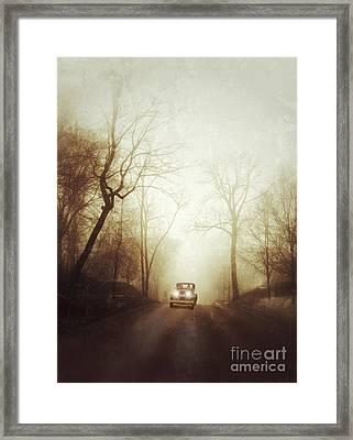 Vintage Car On Foggy Rural Road Framed Print