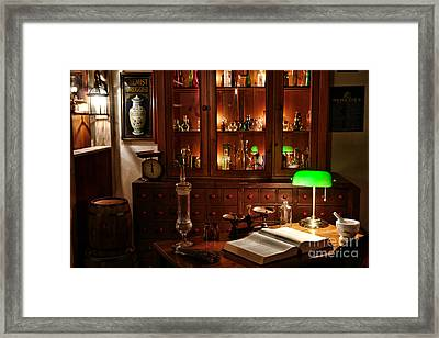 Vintage Chemist Desk In Apothecary Shop Framed Print by Olivier Le Queinec