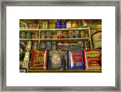 Vintage Garage Oil Cans Framed Print by Bob Christopher