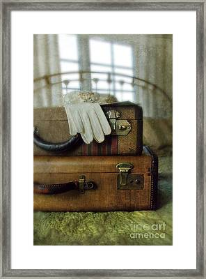 Vintage Suitcases On Brass Bed Framed Print by Jill Battaglia