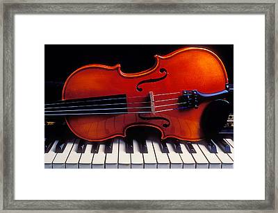 Violin On Piano Keys Framed Print by Garry Gay