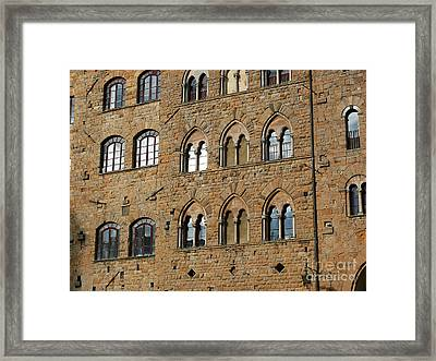 Framed Print featuring the photograph Volterra Wall Of Windows by Jeanne  Woods