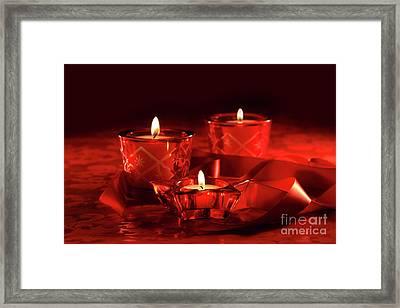 Votive Candles On Dark Red Background Framed Print by Sandra Cunningham