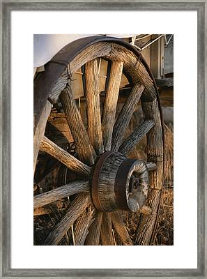 Wagon Wheel On Covered Wagon At Bar 10 Framed Print by Todd Gipstein