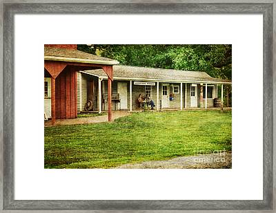 Waiting By The General Store Framed Print by Paul Ward
