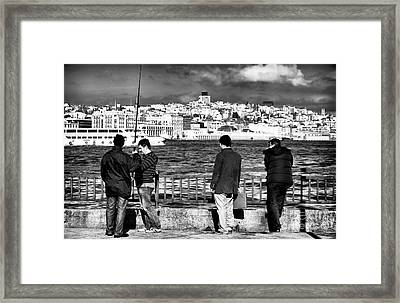 Waiting For The Big Catch Framed Print by John Rizzuto