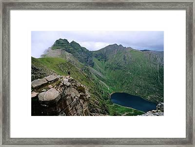 Walker Approaching Summit Of An Teallach, Dundonnell, United Kingdom Framed Print by Mark Daffey