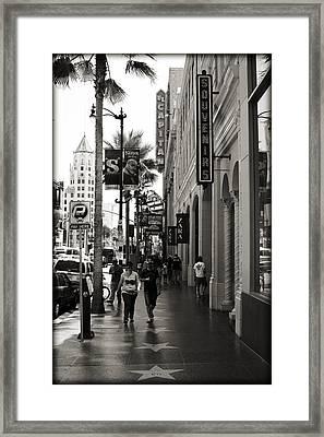 Walking In La Framed Print by Ricky Barnard