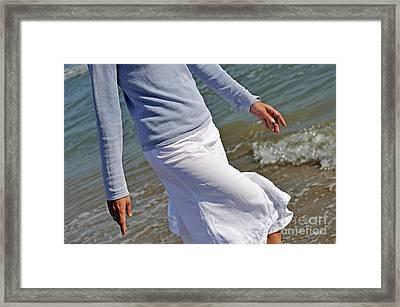 Walking In Water On Beach Framed Print
