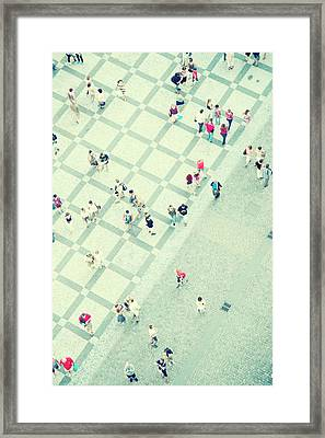 Walking People Framed Print by Carlo A