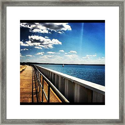 Walking The Dam  Framed Print