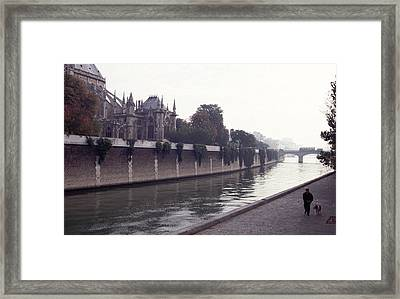 Framed Print featuring the photograph Walking The Dog Along The Seine by Tom Wurl