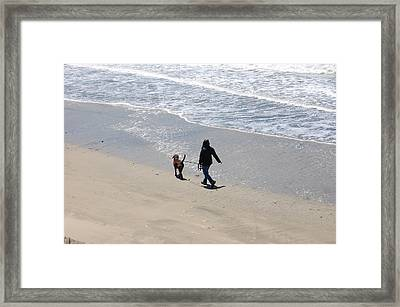 Walking The Dog Framed Print by Carolyn Donnell