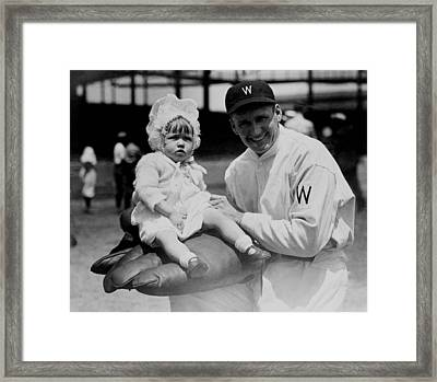 Framed Print featuring the photograph Walter Johnson Holding A Baby - C 1924 by International  Images