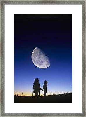 Waning Gibbous Moon Framed Print by David Nunuk
