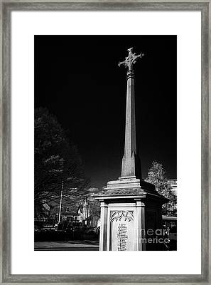 war memorial cenotaph with high cross in rutland square Bakewell market town in the high Peak Framed Print by Joe Fox