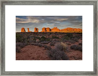 Warm Glow Over Arches Framed Print by Andrew Soundarajan