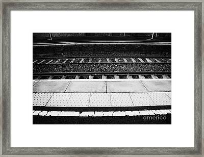 Warning Line And Textured Contoured Tiles Railway Station Platform And Track Northern Ireland Framed Print by Joe Fox