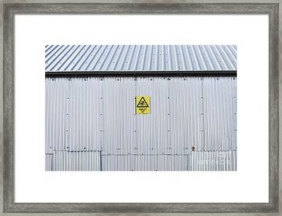 Warning Sign On An Industrial Building Framed Print by Iain Sarjeant
