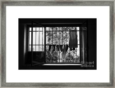 Washing Hanging Off Security Cage In An Apartment In Buenos Aires Framed Print by Joe Fox