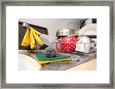 Washing Up Framed Print by Tom Gowanlock