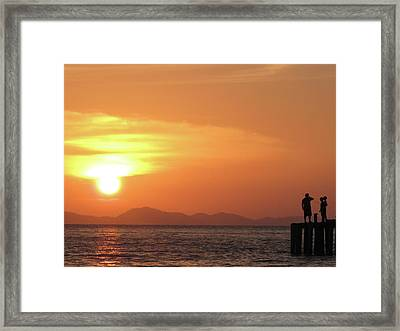 Watching A Sunset From The Jetty Framed Print by Thepurpledoor